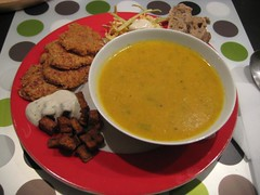 Creamy carrot soup, parsnip patties, coleslaw and spicy tofu with ...