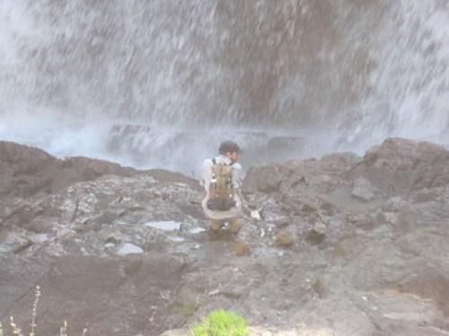 man on rocks at Kabir Kouba falls with Wendake Tarahumara pack