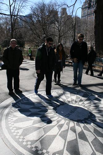 Brian standing near Imagine memorial
