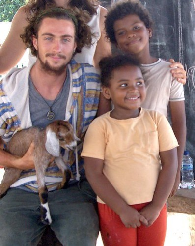 Aaron Johnson with locals
