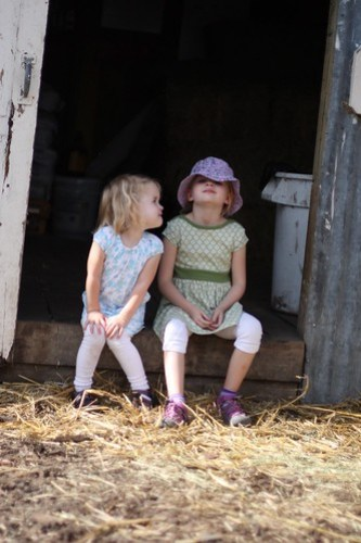 Claire and Juliet in the barn at the goat farm