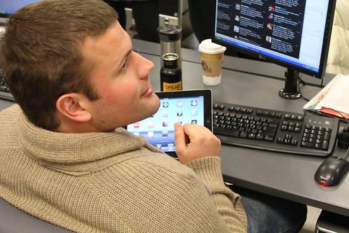 Jacob Kuehn familiarizes himself with the iPad.