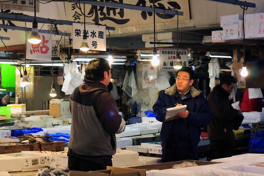 men in the tokyo fish market