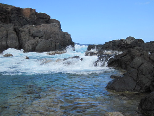 Rock pools are filled by the surf