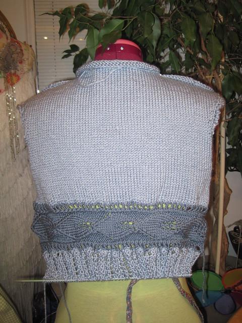 blue peplum sleevless sweater