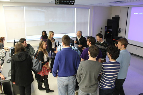 Instructor Wayne MacPhail, centre, explains the project to the aggregation groups