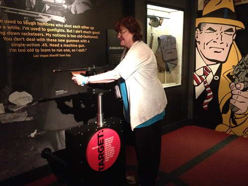Mary shooting a tommy gun at the Mob Museum