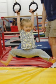 My 2.5 year old daughter learning the rings at her gymnastics class.