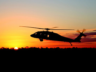 Helicopter taking off in the sunset