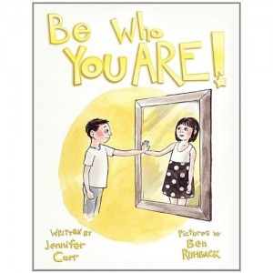"The cover of Be Who You Are depicts a ""boy"" looking in the mirror at herself as a girl."