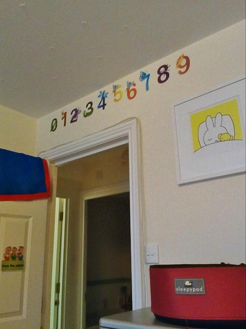 Adult baby bedroom door with number stickers, Miffy print and name-plate on the door