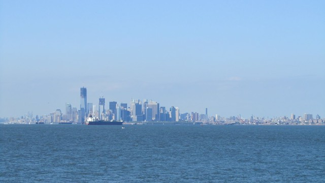 view of Manhattan from inside the Staten Island Ferry