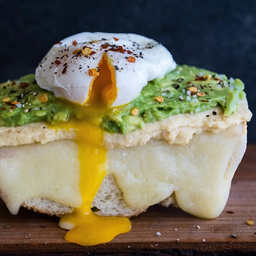 breakfast baguette with hummus, avocado, and melted gruyere