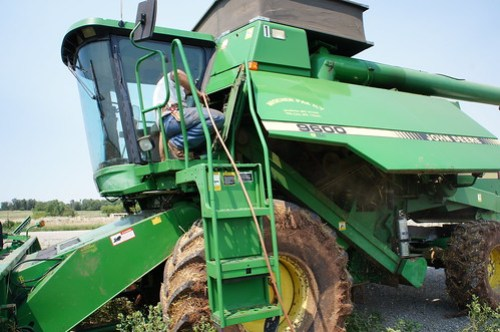 Vincent cleaning blowing out the combine