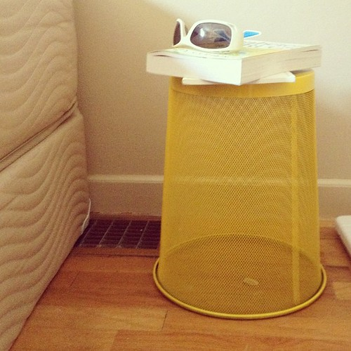 Pinterest inspired bedside table. Trash can flipped over and painted. Take that, no one in particular.