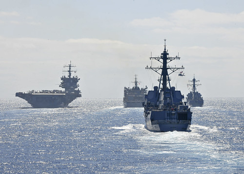 U.S. Navy ships conduct a replenishment at sea.  by Official U.S. Navy Imagery