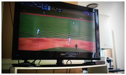 Watching baseball on TV.