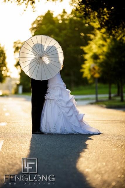 Bride & Groom Parasol Shadow Kiss | Sarah & Alex's Wedding | Sacred Heart Cultural Center | Augusta Destination Wedding Photographer