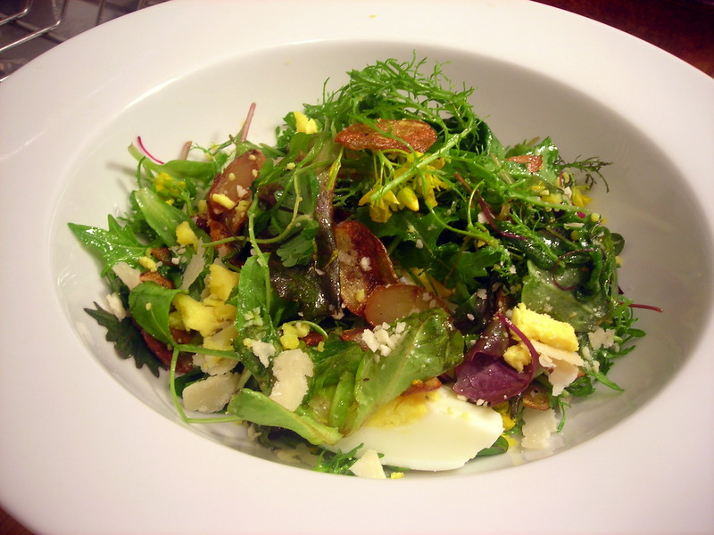 Spring lettuce salad with salt-and-vinegar Roseval potato chips, roasted shallots, hard-cooked farm egg and Parmigiano-Reggiano cheese