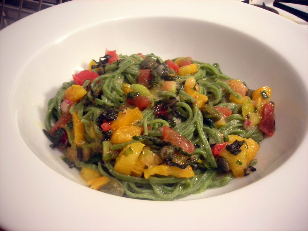 Spinach tagliolini pasta with uncooked heirloom tomato sauce