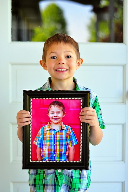 Last Day of School, Holding Photo from First Day of School