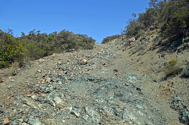 A steep, unshaded old mine road takes you back up to the saddle.