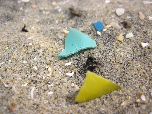 Tiny plastic bits in the sand