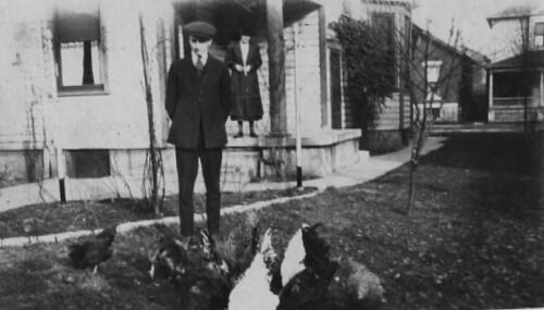 1920-Carl with his chickens