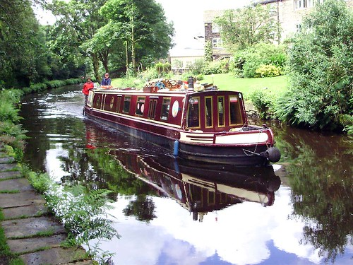 Narrow boat approaching Uppermill