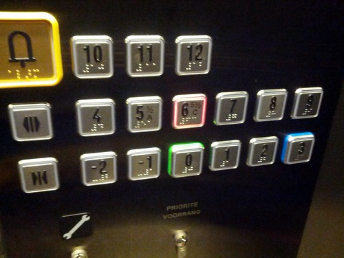 Lift button with floor 5.5 on it, so that the top story is 12, not 13, European Parliament, Brussels, Belgium