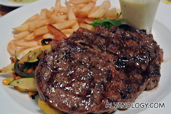 Entrecôte: Grilled grain-fed Beef Rib-eye 280gm with 'La Villa Butter sauce' Fries and Market Vegetables