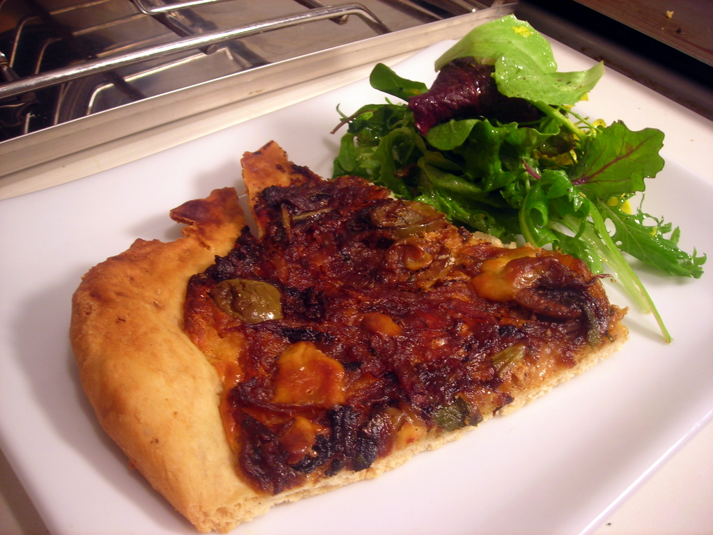 Caramelized onion tart, with cow's milk ricotta cheese, fromage blanc, olives and sage; spring garden salad