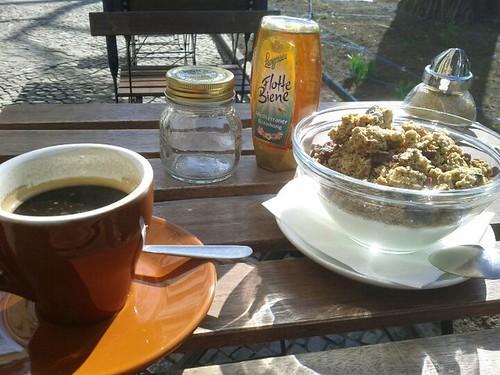 americano, sun and yoghurt with granola.