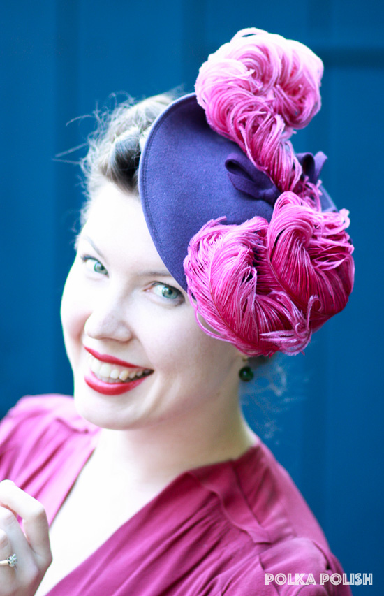 Over-the-top 1940s tilt hat by New York Creations with a purple felt base and raspberry pink ostrich feathers