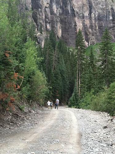 Walking behind Telluride at Bridal Veil