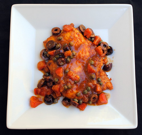 Flattened chicken with tomatoes, olives & capers