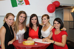 The PR girls with the Mexican Flag at INTERNeX Summer Party