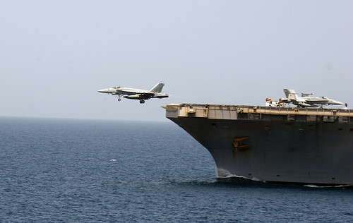 A jet launches from the USS Abraham Lincoln. by Official U.S. Navy Imagery