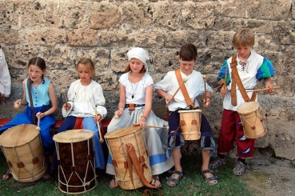 Children playing drums at Burgfest Castle festival