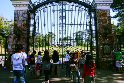 Visitors in front of The Mansion House gates