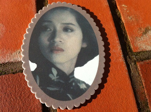 Handmade brooch featuring actress Anita Mui from the film Rouge