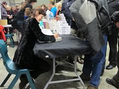 Sylvie Simmons signs books
