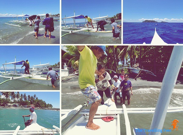 riding the boat going to Apo Island
