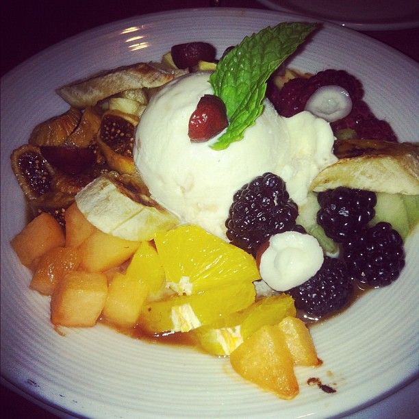 Vanilla ice cream with fresh fruit and mini coconuts.