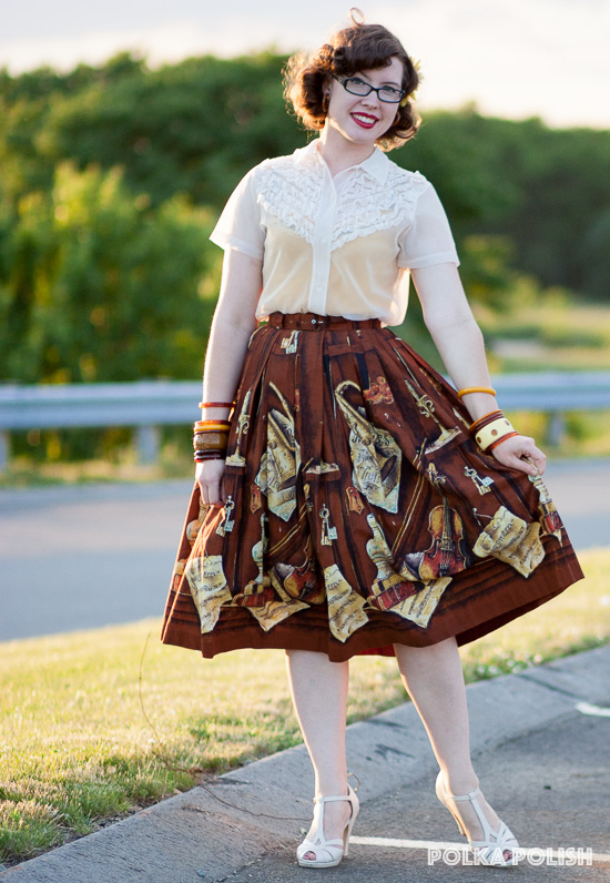 A 1950s inspired look featuring an amazing novelty-print skirt with a pattern of sheet music and instruments
