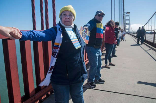 Thamar Ramirez, a Venezuelan citizen who arrived in San Francisco just two weeks ago, links hands with other protesters to form a human chain across the Golden Gate Bridge during a demonstration in support of the Venezuelan people Sunday, Feb. 23. Photo by Jessica Christian / Xpress