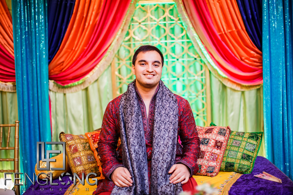 Groom sitting on stage waiting for bride