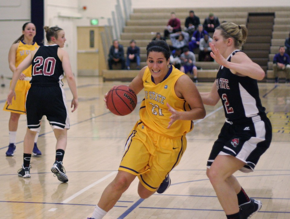 Katie Batlin (#21) dodges the other team at the SF State vs. Chico State Women's Basketball game at the Swamp on Friday, Dec. 6, 2013. Photo by Ryan Leibrich / Xpress