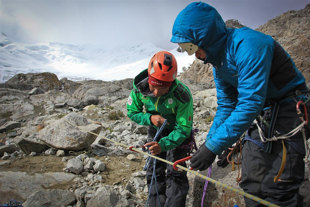 Practice makes perfect. Yanapaccha (5460m) plays hide and seek in the fickle weather. Cordillera Blanca. Peru.
