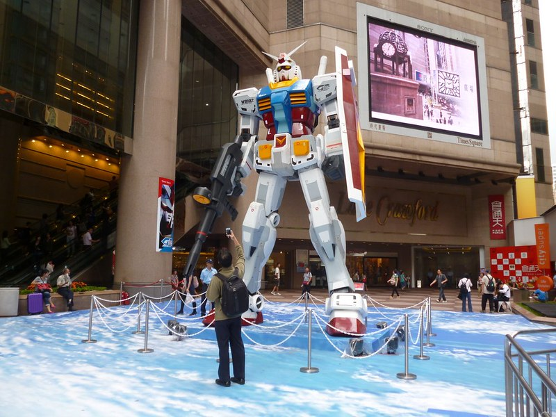 Gundam character in front of Time Square
